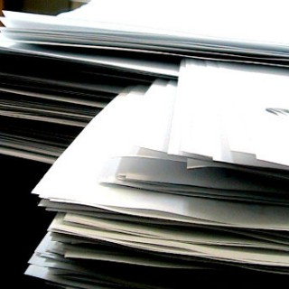 Stacks of White Paper by FeatherdTar