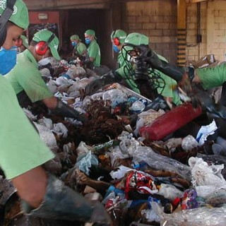 http://grist.org/cities/houstons-one-bin-to-rule-them-all-recycling-plan-smells-a-little-like-racism/