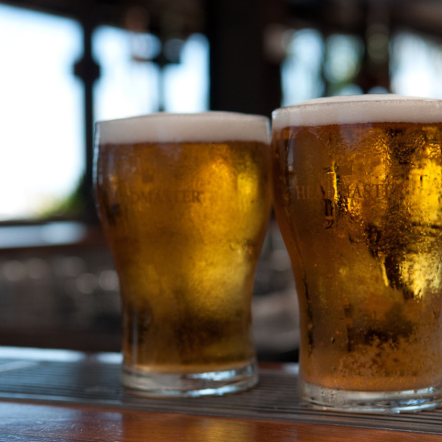 Photo: Two beer glasses.