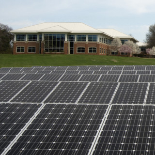 solar panels and building - flickr USDA
