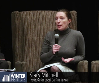 Photo: Stacy Mitchell speaks at the 2016 Winter Institute.