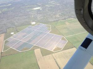 Aerial photo of Austin's 30 MW solar farm in Webberville (credit: tdog via Wikimedia Commons)