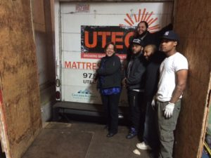 Cascade Alliance Director Sue Palmer emoting enough joy to cover all the guys working at mattress recycling at UTEC in Lowell, MA.