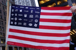 Photo: A U.S. flag with corporate logos.