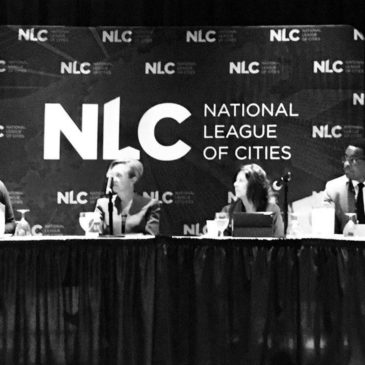 Photo: Stacy Mitchell moderates panel at NLC.