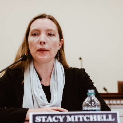 Photo: Stacy Mitchell speaking at Congressional briefing.