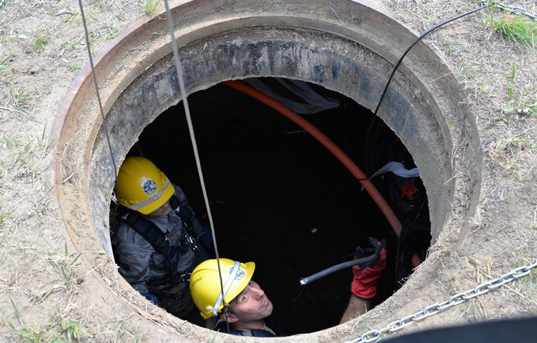Workers in manhole