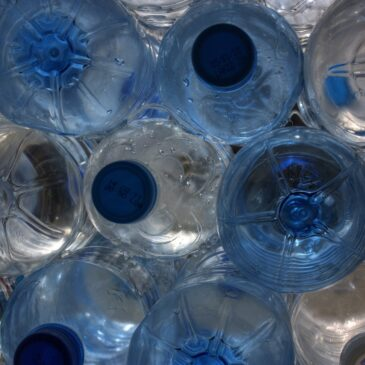A collection of white and blue water bottles