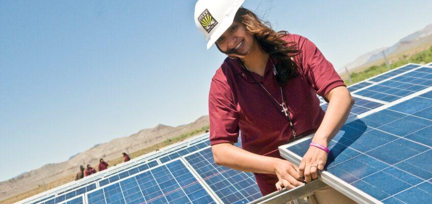 Woman installing solar panels