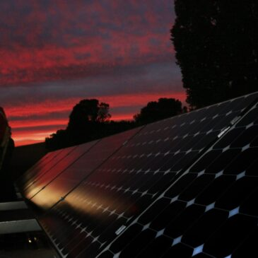 Sun sets over solar panels by the Washington monument