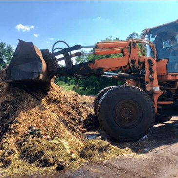 A compost pile being built at the Hudson Soil Company's on-farm composting site
